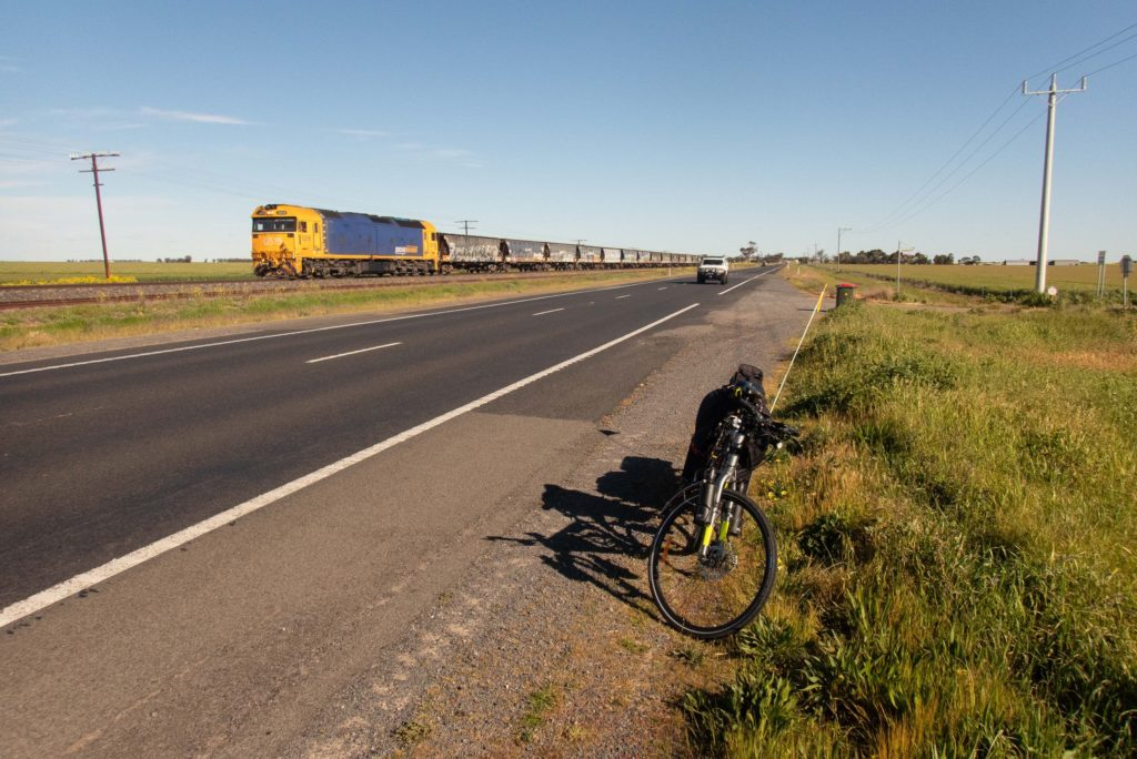 Freight train passing on the Western Highway between Horsham and Pimpinio